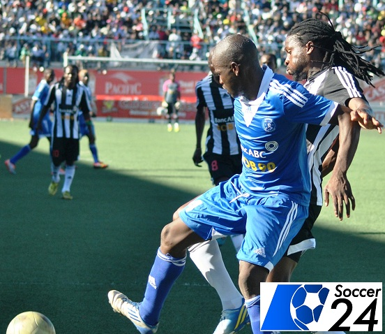 Clive Kawinga and Felix Chindungwe tussle for the ball